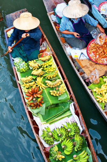 High angle view of vendors selling food at floating market