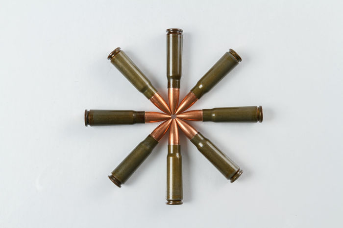 7.62x39 caliber rifle cartridges arranged in the shape of a star 7.62x39 Ammo Ammunition Arrangement Built Structure Caliber Cartrip Close-up Ideas Medium Group Of Objects No People Overhead View Rif Shape Sharp Simplicity Still Life Studio Shot Target Shooting Variation White Background
