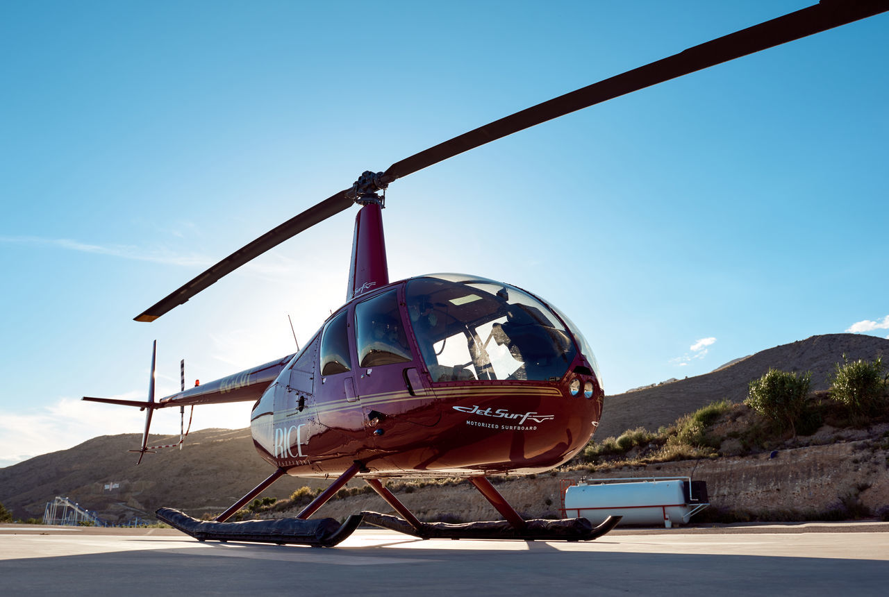transportation, sky, mode of transport, travel, day, outdoors, airplane, sunlight, mountain, clear sky, no people, nature, air vehicle, blue, ski lift