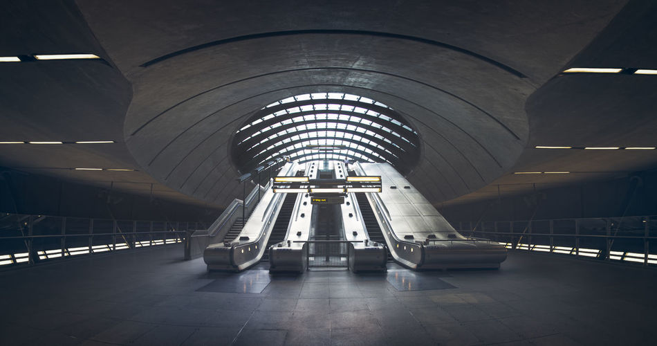 Canary wharf station is an impressive concrete structure, which is awesome to try and capture. This picture was a really wide panorama (about 9 vertical images) to try and fit everything in. Awesome Beautiful Britain Canary Wharf Color Color Grading Concrete Cool England Escalator Europe Exit Grey Light London Panorama Perspective Sightseeing Sign Tourist Transportation Tube Uk Underground Wide Angle