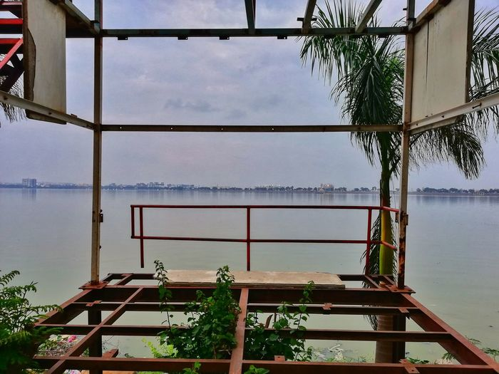Mobilephotography Shot On Mobile P20lite Honorphotography Huwaei Photography Huawei P20lite Frame Evening Lake View Prospective Bars Tree Lines Structure Broken Shear Water Lake Sky Stilt House Stilt