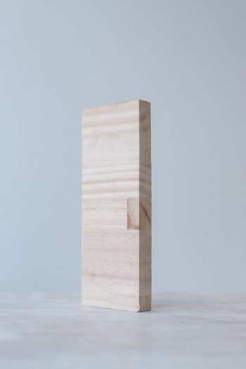 Wooden board texture stand on grey background Standing Wood Block Block Shape Copy Space Cube Shape Gray Background Indoors  Minimal Plywood Single Object Studio Shot Toy Block Wood - Material Wood Cut Wood Texture Wooden Board