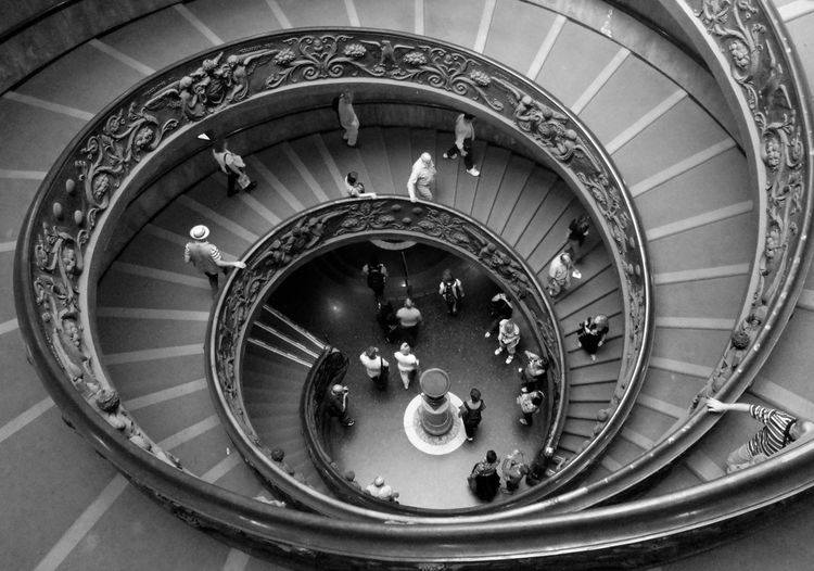 High Angle View Of People Walking On Spiral Staircase In Vatican Museum