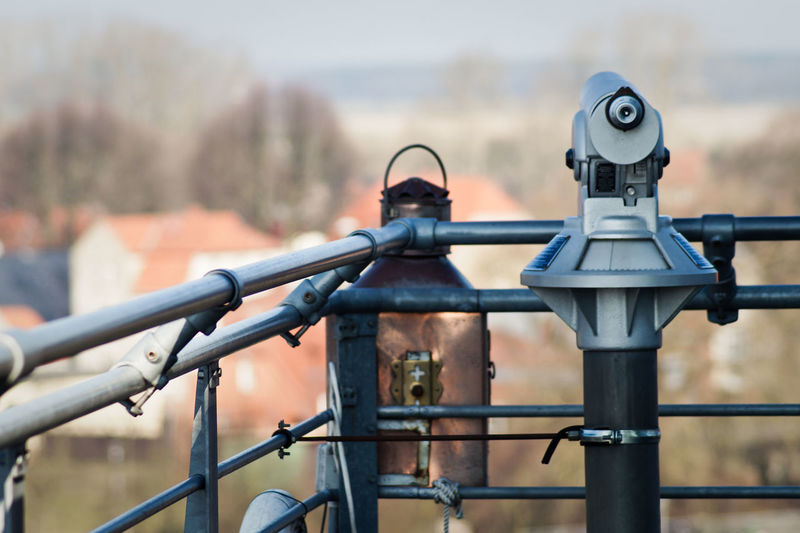 Close-up of coin operated binoculars against blurred background