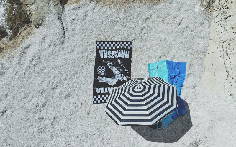 A view from above Summertime Towels Beach High Angle View Sign Day No People Sunlight Street Communication Nature Outdoors Pattern Textured  Text Symbol Blue