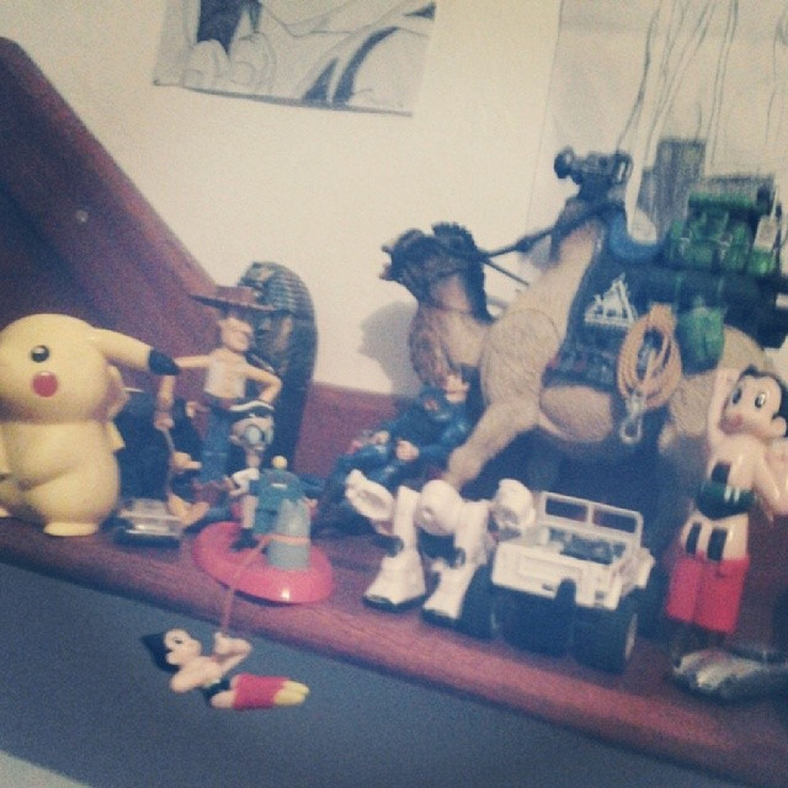 indoors, animal representation, toy, art, art and craft, creativity, human representation, home interior, variation, still life, table, animal themes, close-up, no people, glass - material, high angle view, figurine, craft