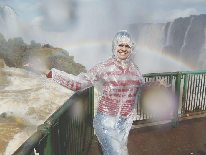 Portrait of female tourist wearing raincoat at iguacu falls