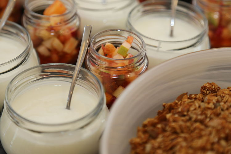 High angle view of yogurts and pickles