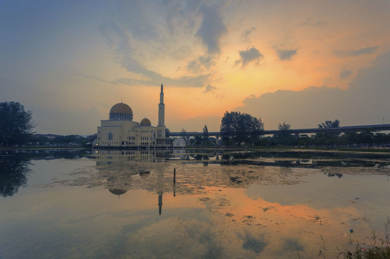 Beautiful scenery of sunrise at al-Salam Mosque, Puchong Perdana, Malaysia with reflection Arab Architecture Blue Cloud Dome Dusk Islamic Architecture Landmark Landscape Minaret MUHAMMAD Muslim Nature No People Outdoors Place Of Worship Reflection Religion Sky Sky And Clouds Sun Sunrise Sunset Travel Destinations Water