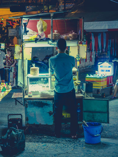 Market Men Rear View One Person Market Stall Retail  Real People Small Business For Sale Standing Business Choice Shopping Selling Occupation Food Food And Drink Large Group Of Objects Casual Clothing Street Market Sale Street Food Consumerism