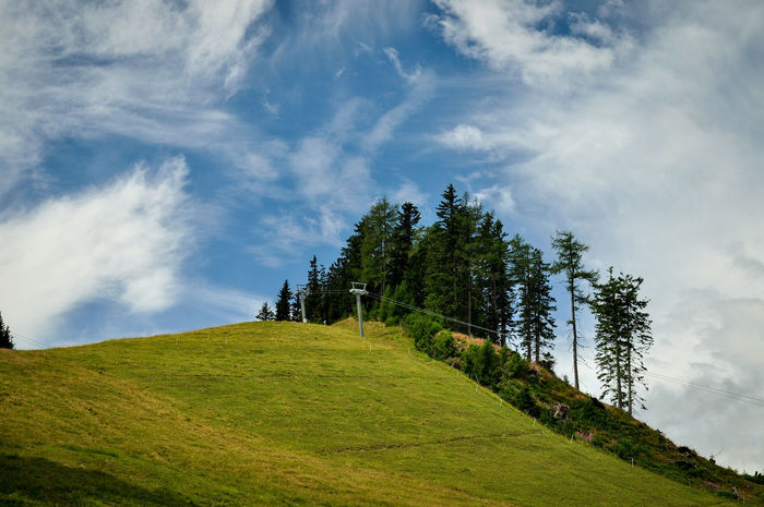 Cloud Beauty In Nature Cloud - Sky Day Grass Green Color Growth Landscape Mountain Nature No People Outdoors Scenics Sky Slope Tranquil Scene Tranquility Tree
