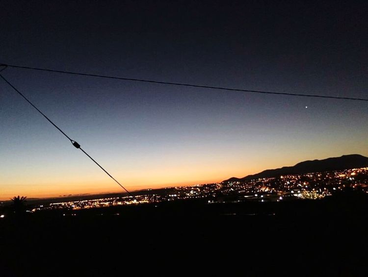 Sunset Nature Silhouette Beauty In Nature No People Scenics Cable Mountain Sky Tranquil Scene Electricity  Water Landscape Night Clear Sky Telephone Line