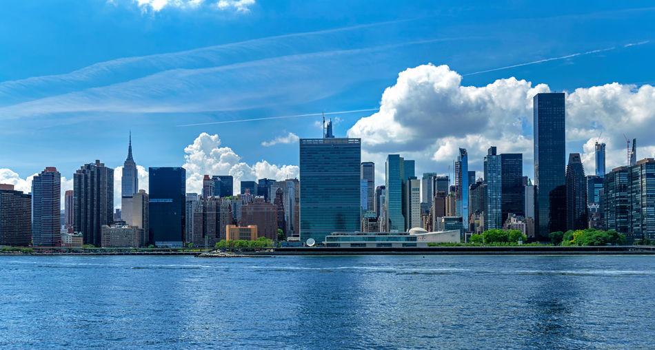 Modern buildings in city against sky