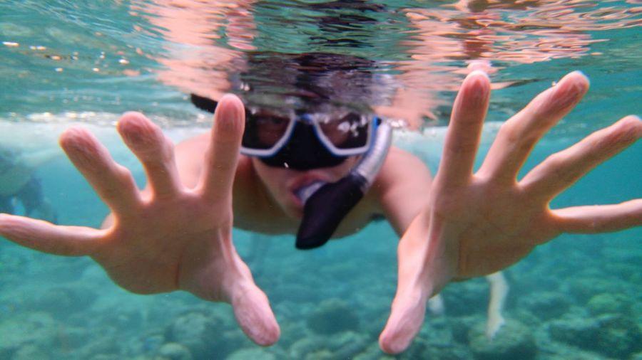 Man Wearing Snorkel Swimming Undersea