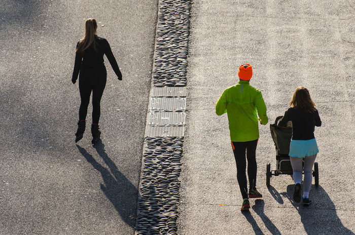 Bachelor Couple Day Family Friendship Full Length Jogging Leisure Activity Life Lifestyles Men Outdoors People Real People Rear View Road Running Separation Shadow Single Togetherness Two People Walking Women