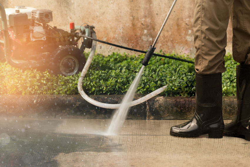 High pressure cleaner. Cleaning Equipment Cleaning Cleaning Service Day Driveway High Pressure Cleaner Low Section Motion One Person Outdoors People Professional Services Real People Splashing Spraying Washing Water Wet