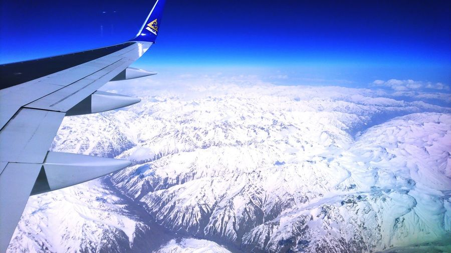 Natural wonders of the world. EyeEmNewHere Nature World Mountain Snow No People Airplane Aerial View Air Vehicle Flying Cold Temperature Snow Nature Outdoors Day Winter Sky Blue Beauty In Nature Journey Travel Transportation Airplane Wing Landscape The Natural World Scenics Colour Your Horizn Go Higher