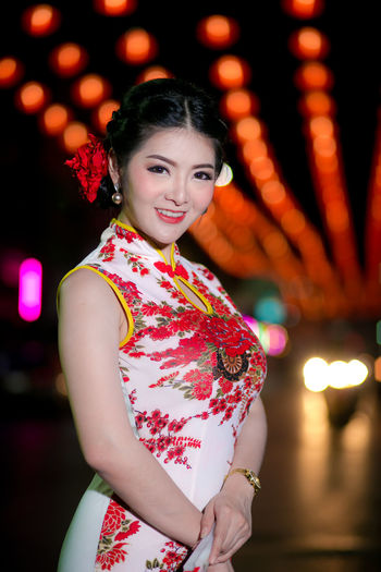 Portrait beautiful Asian woman in Cheongsam dress(Red Chinese dress), Happy Chinese new year concept with night light. Asian  Beautiful Dress Happy People Light Red Thailand Woman Beautiful Woman Cherrful China Chinese Cultures Cute Happy Chinese New Year Lovely Nakhonsawan Night Portrait Smile Smiling Traditional White Color Young Adult Young Women