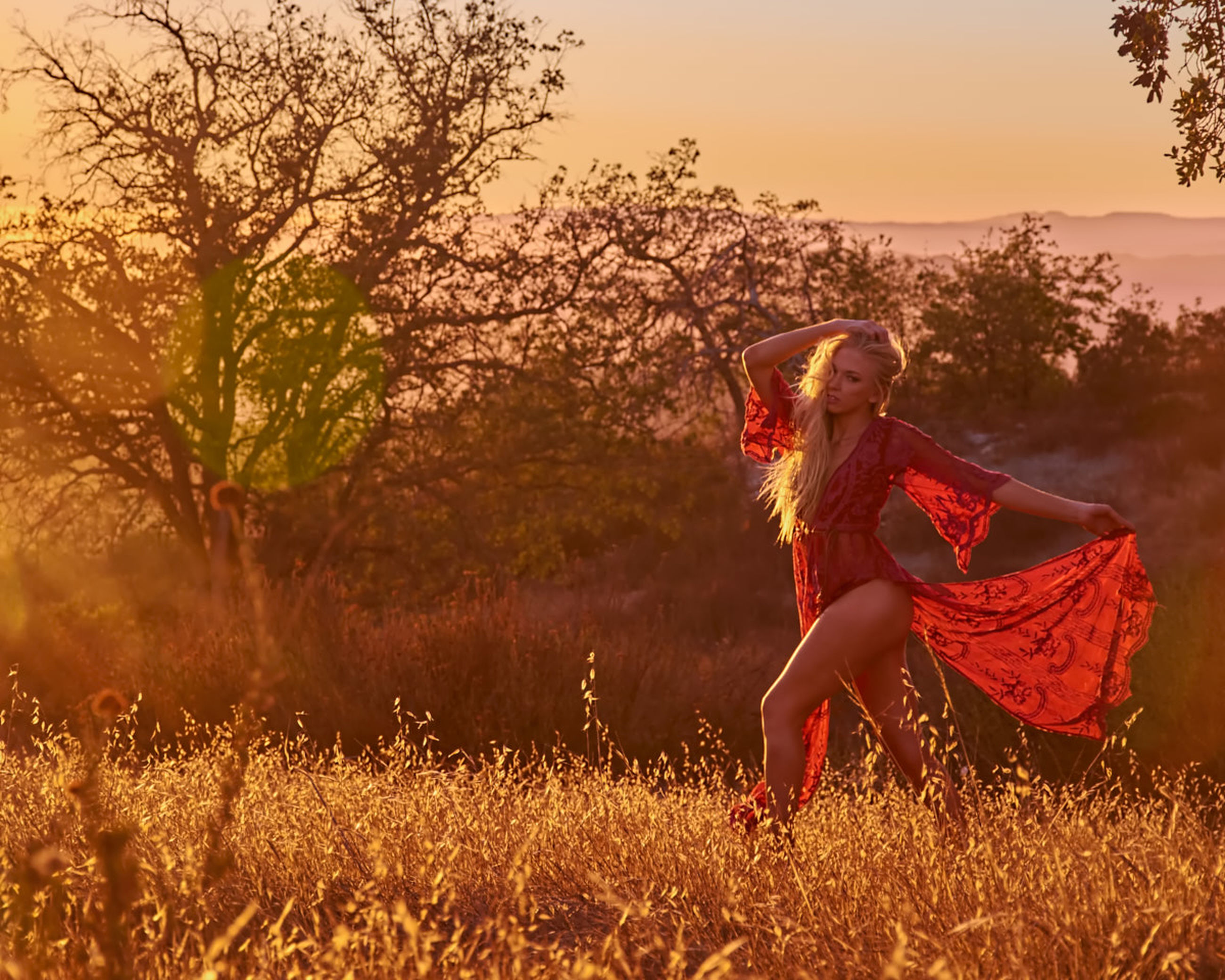 plant, leisure activity, one person, tree, women, real people, young women, lifestyles, field, land, young adult, clothing, nature, full length, sunset, grass, sky, casual clothing, fashion, beautiful woman, hairstyle, outdoors