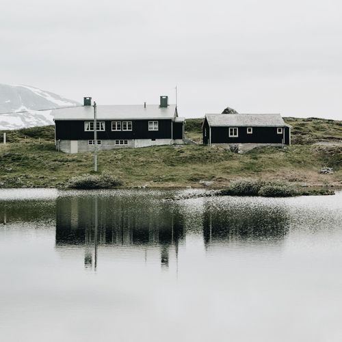 This is Norway. Built Structure Water Building Exterior Architecture Reflection Lake No People Day Outdoors Nature Sky Norway Tranquility Bygdin Valdresflya
