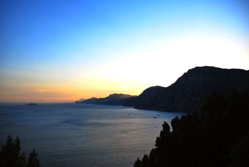 Positano, Italy Beach Beauty In Nature Blue Clear Sky Day Horizon Over Water Mountain Nature No People Outdoors Scenics Sea Silhouette Sky Sunset Tranquil Scene Tranquility Water