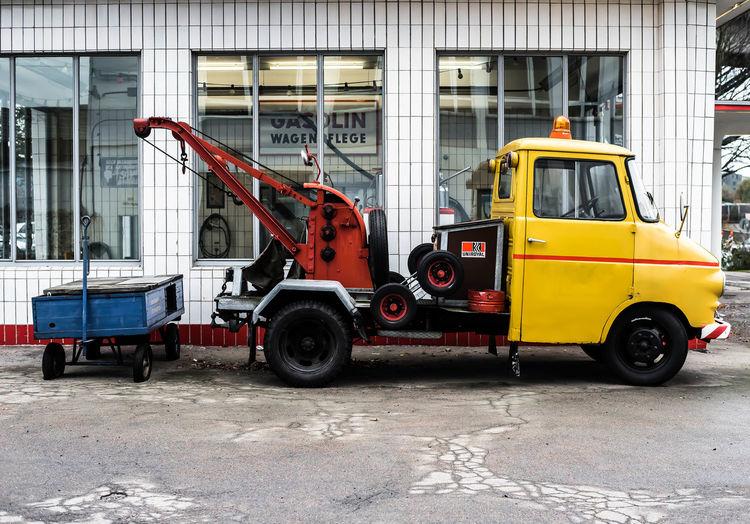 Vintage car parked against built structure