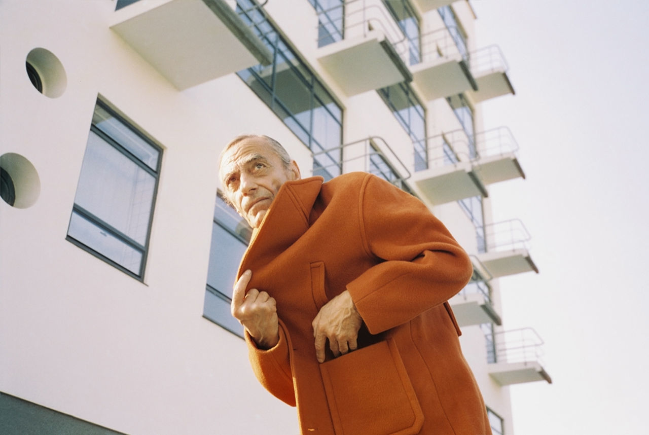 LOW ANGLE VIEW OF TWO PEOPLE HOLDING APARTMENT