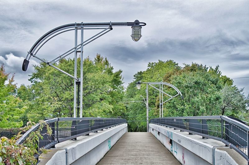 Architecture Bridge Bridge - Man Made Structure Built Structure Cloud - Sky Day Electric Lamp Lighting Equipment Metal Nature No People Outdoors Plant Railing Sky Street Street Light Transportation Tree Water