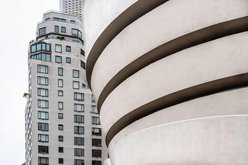 Solomon R. Guggenheim Museum in New York Architecture Day Manhattan NYC NYC Street Photography America American Architecture Solomon R. Guggenheim Museum Museum Frank Lloyd Wright Frank Lloyd Wright Architecture Guggenheim Guggenheimmuseum Guggenheim Nyc Travel Travel Destinations Tourism Tourist Attraction  Built Structure Building Exterior No People Low Angle View City Building Nature Outdoors Sky Storage Tank Sunlight White Color Cylinder Water Tower - Storage Tank Modern Sunny Pattern