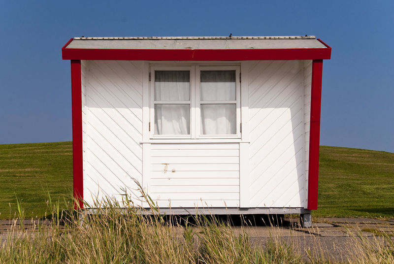 Bathing Hut in Dagebüll, Germany Bath Bathing Colors Grass North Sea Coast Architecture Beach Building Cabin Color Colorful Cottage Dagebüll Day Dyke  Germany Grass Hut No People North Sea Outdoors Shed Sky Wadden Sea