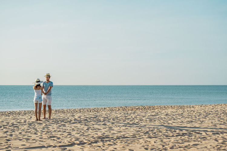 Adult Beach Bonding Couple - Relationship Emotion Full Length Heterosexual Couple Horizon Horizon Over Water Land Love Mature Men Men Nature Outdoors Positive Emotion Sea Sky Standing Togetherness Trip Two People Water