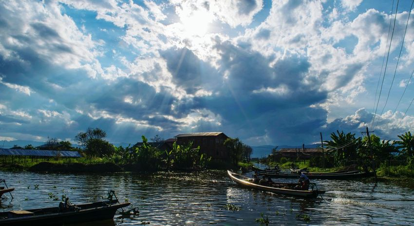 EyeEmNewHere Ray Of Light Cloudy Lake View Water Boats Nature Reflection Lake Myanmar Sky And Clouds Let's Go. Together.