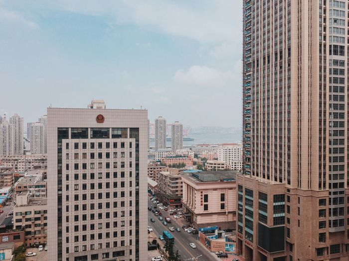 Dalian, Liaoning, China 2017 MelbournePhotographer IPhoneography Mobilephotography Streetphotography Adobelightroommobile Vscocam Architecture Building Exterior Skyscraper Built Structure City Cityscape Day Sky Travel Destinations Outdoors No People Modern
