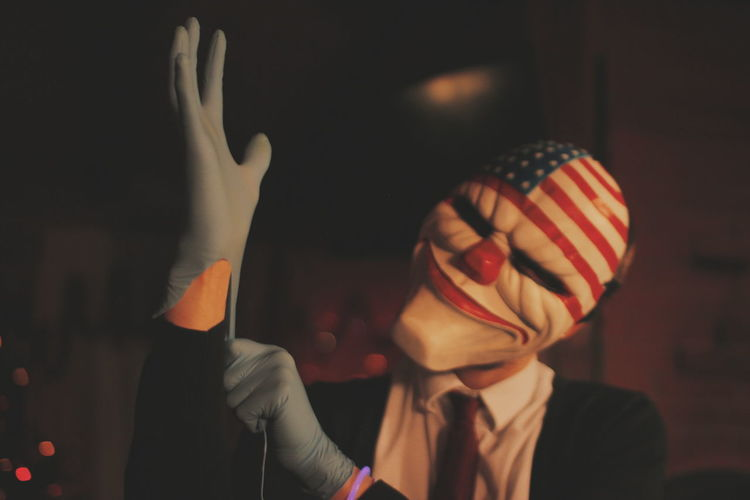 Man In American Flag Mask Wearing Surgical Gloves During Halloween
