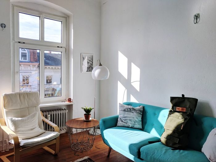 Home Interior Sofa Living Room Indoors  DIY Luxury House Chair Home Showcase Interior Window Armchair Villa No People Lifestyles Furniture Day Apartment Architecture Holiday Villa Pillow Berlin Apartment Afternoon Light Morning Light High Ceilings Sunlight