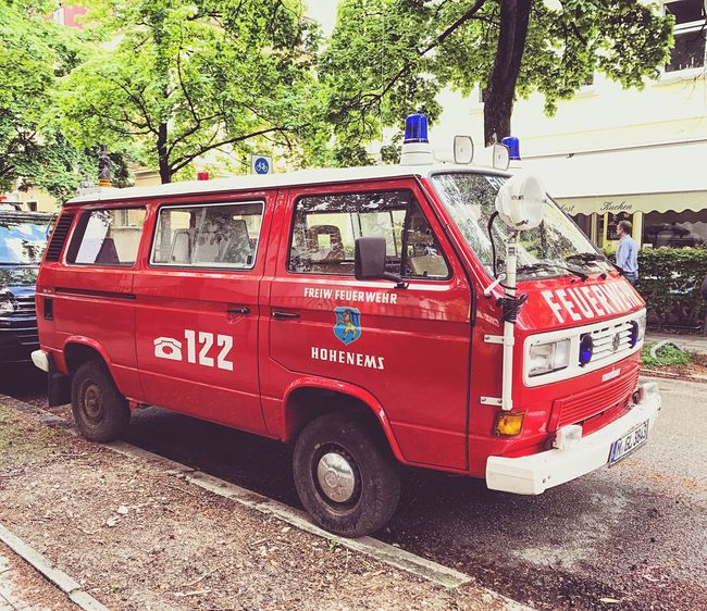 Red Rescue Fire Engine Land Vehicle Emergency Services Occupation Accidents And Disasters Tree Architecture Day Munich Taking Photos EyeEmNewHere Hello World Photography Enjoying Life Beautiful Travel Love Streetphotography No People Outdoors