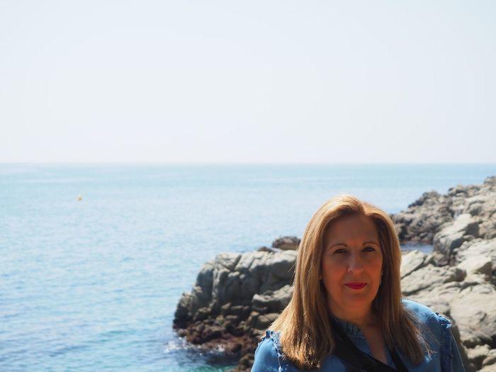 Portrait of woman against sea