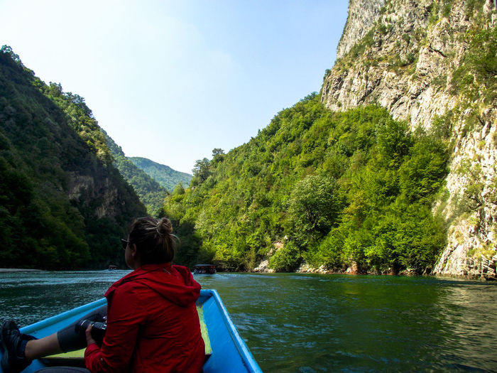 One Woman Only Red Color Tree Water Mountain Sitting Nautical Vessel Women Lake Rear View Oar Adventure Hiker Countryside Lush - Description Lush Foliage Rocky Mountains Mountain Range Backpack Hiking Greenery Stream Water Vehicle