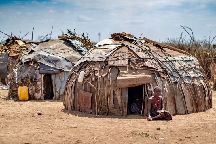 Dassanech tribe village Dassanech Tribe African Portrait Of A Woman Ethiopian Photography 🇪🇹 Ethiopia Africa Ethiopian Portraits Portrait Photography Tribes Tribe Tribal Built Structure Architecture Land Nature Building Exterior Sky Day Building Cloud - Sky Beach One Person Sunlight Real People Plant Tree Outdoors Sand Lifestyles