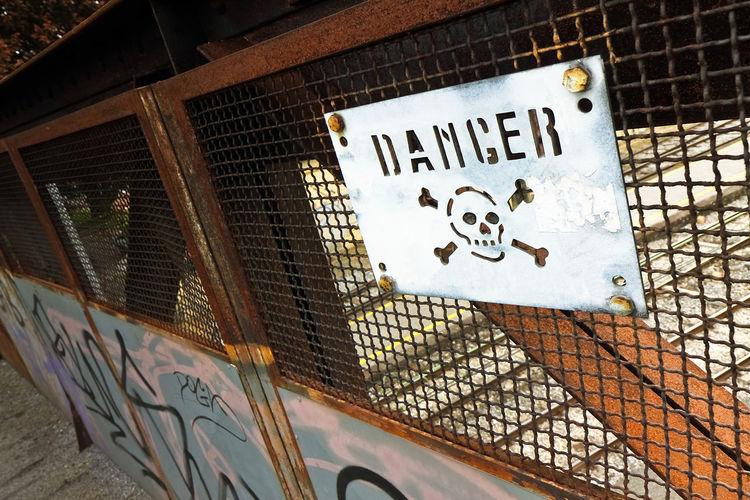 Danger concept Grid Risk; Danger Danger Zone Dead; Fence Fencing Information Information Sign