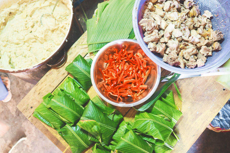 The making of Tamales: assembling the tamales Atitlan Lake Banana Leaf Central America Cooking Food Food And Drink Food And Drink Freshness Healthy Eating Herb Home Cooking Ingredient Mexican Food No People Preparing Food Spice Tamales Travel Photography