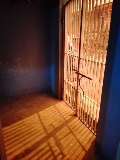 Ways Of Seeing: Stripes 15 Ways Of Seeing: Silence Deep Orange Band Blue Blue Walls Behind The Bars Outside Of The Gate On The Other Side Mysterious Something Mysterious Hot Weather Here Alone Eyeem Market Captivated Light Captivated Blues And Oranges Shadow Door Sunlight Architecture Built Structure
