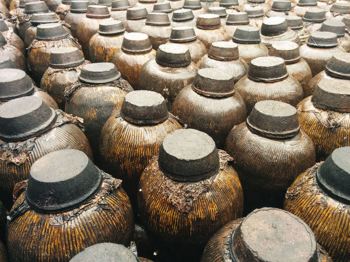Jugs of distilled liquor at distillery in wuzhen