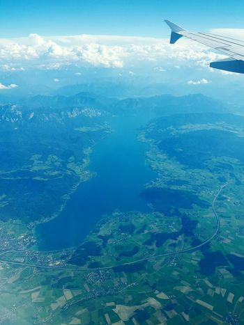 Ladyphotographerofthemonth Landscape_photography Light And Shadows EyeEm Awards 2016 Bird Perspective Landscape Dreamscapes Clear View From An Airplane Window Vogelperspektive Airplanes From Above  From An Airplane Window View From An Airplane Lake View From Above World Looks Smaller Wing Of Plane Alpes Alpen Mountains From The Plane Window From Above The Clouds Showcase June On The Way Flying High Lost In The Landscape