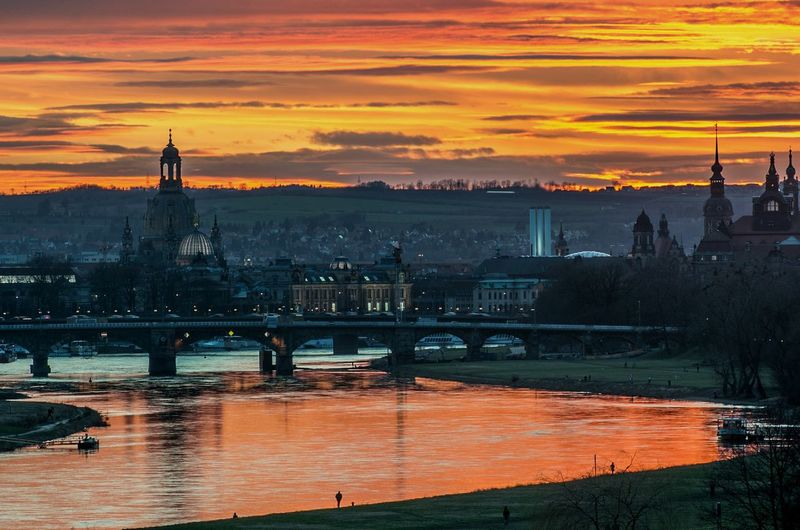 Cityscape with elbe river against orange sky during sunset