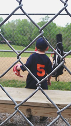 The Moment - 2015 EyeEm Awards The Portraitist - 2015 EyeEm Awards Childhood Baseball Perspective Out Of Focus Focus Little Boy Playing Ball Thru The Fence