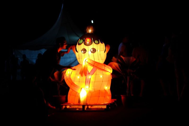 Lentern Illuminated Night Celebration Representation Group Of People Glowing Lighting Equipment Candle Real People Human Representation Burning Heat - Temperature Food Food And Drink Orange Color Jack O' Lantern Art And Craft Fire Dark