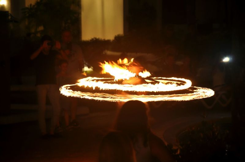 girl is on fire! Night Heat - Temperature Burning Traditional Festival Celebration Flame People Tradition Illuminated Lifestyles One Person Diwali Adult Outdoors Food Adults Only