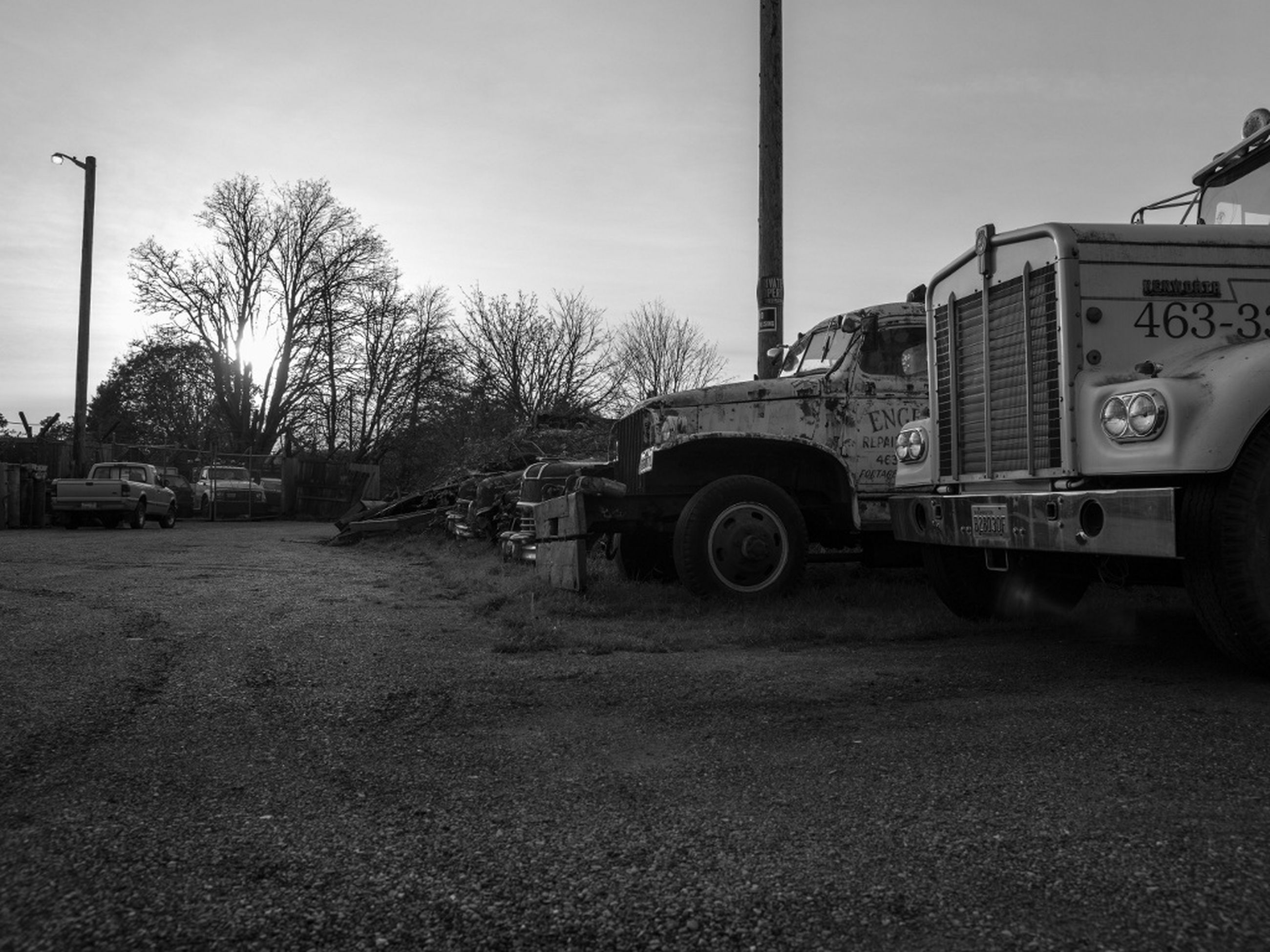 transportation, land vehicle, tree, architecture, sky, mode of transport, built structure, building exterior, car, street, road, day, outdoors, no people, field, sunlight, clear sky, stationary, travel, bicycle