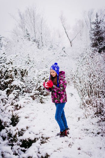 Winter Snow Cold Temperature Warm Clothing Full Length One Person Child Real People Clothing Girls Leisure Activity Childhood Lifestyles Nature Day Females Land Tree Innocence Outdoors Extreme Weather